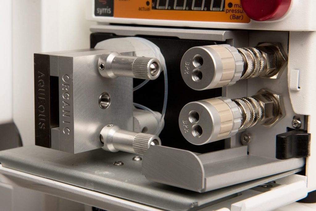 A close up photograph of Syrris Asia Flow Chemistry FLLEX Module for Flow Liquid-Liquid Extraction