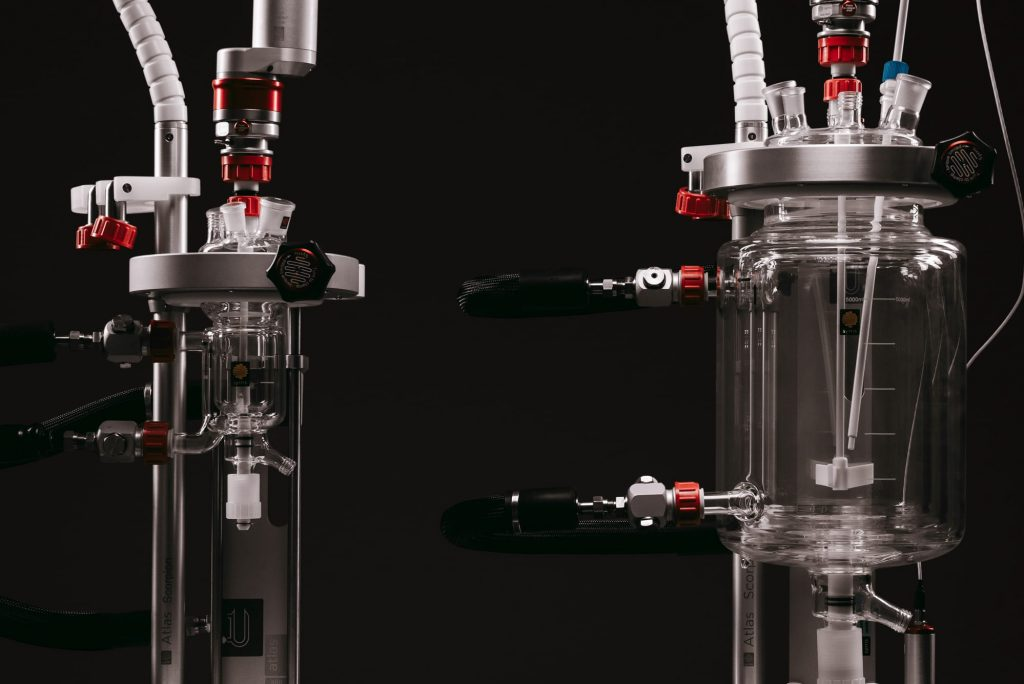 A photograph of 2 Syrris Atlas HD automated chemistry reactors with different size vessels