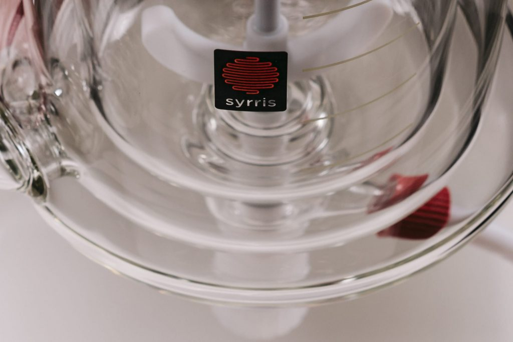 A photograph of a Syrris glass reactor vessel