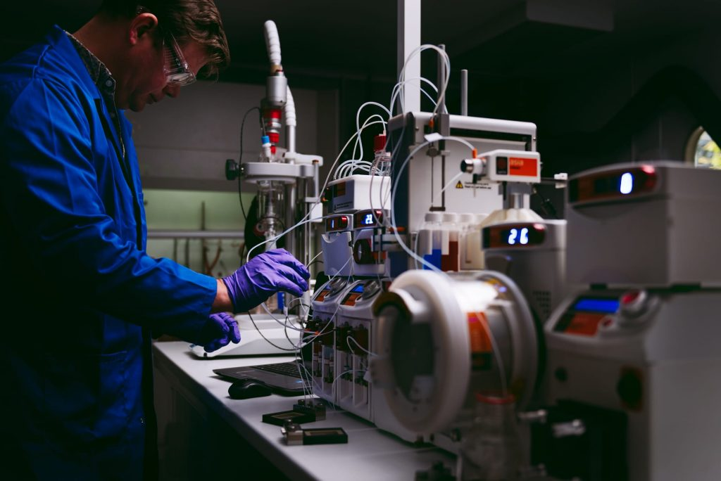 A chemist working on drug discovery and drug development using a Syrris Asia flow chemistry system
