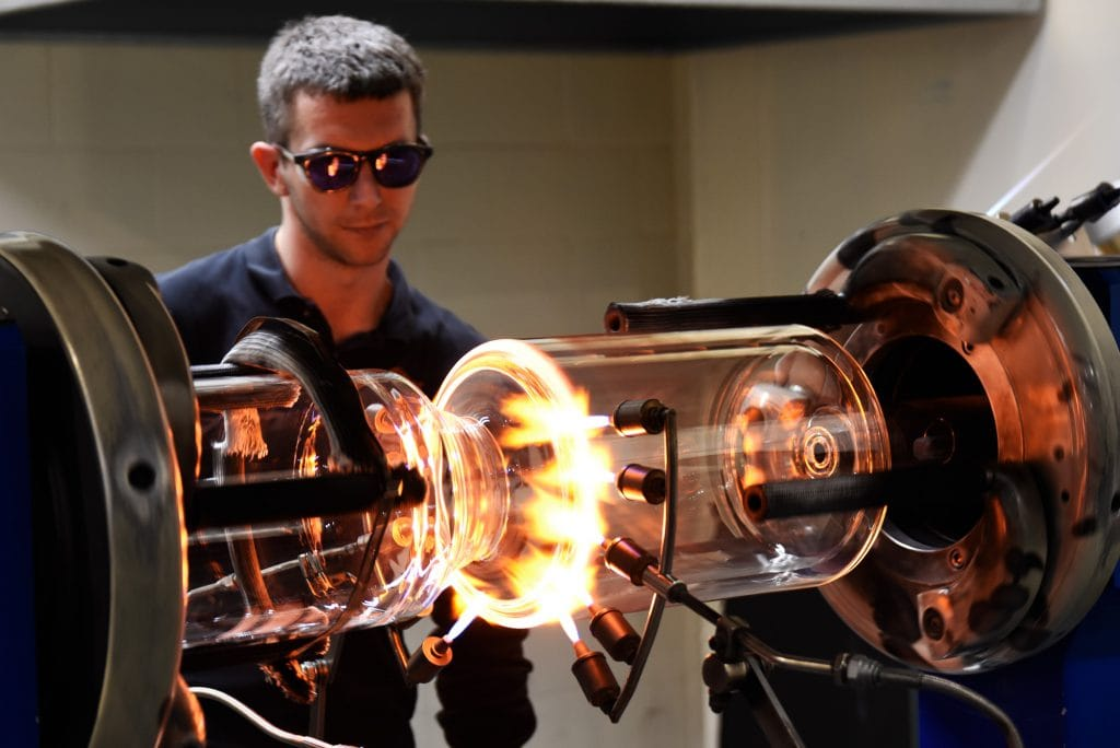 A Glass Solutions' glassblower, creating a glass vessel for an Atlas HD automated chemistry reactor