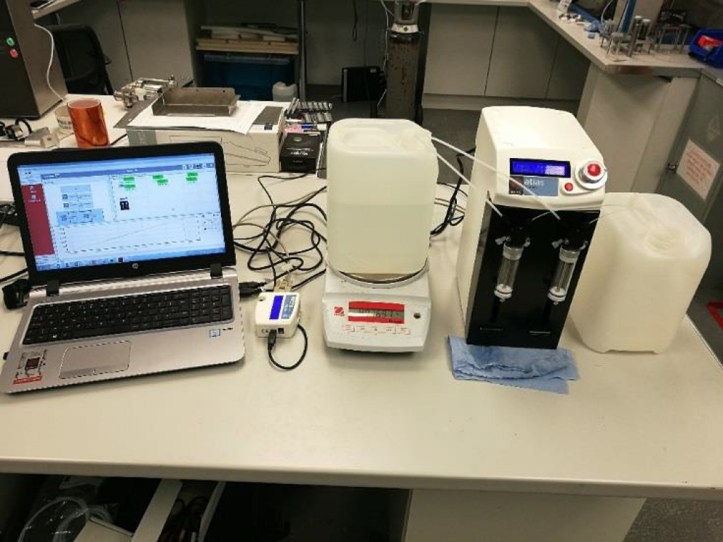 Pseudo-gravimetric dosing setup on Atlas Syringe Pump
