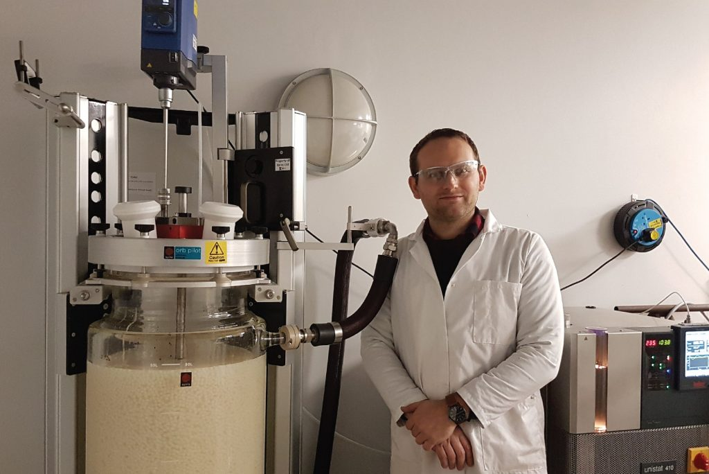Robert Bird at Xeros Technology Group standing next to the Syrris Orb Pilot with custom stirrer and gearbox