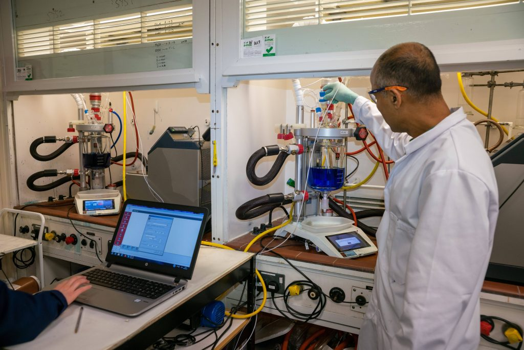 A picture of TauRX's lab showcasing the Atlas HD systems and Atlas Syringe Pumps - Walk-away API process development for TauRX with Syrris Atlas HD